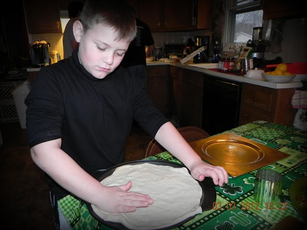 July 5th, 2012 -- Drizzle some oil on the pizza pan and roll out...