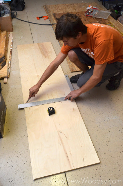 measuring PureBond Plywood with a square