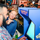 playing 8-bit arcade classics at Bagatelle Tuesdays in Miami, Florida, United States