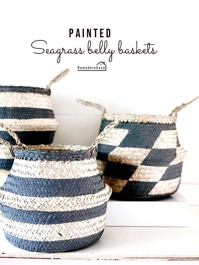 black designs painted on seagrass belly baskets