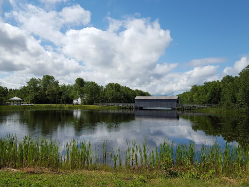 The covered bridge (1900), taking you from the 1800s to the 1900s.  From Acadian History Comes Alive in a New Brunswick Village