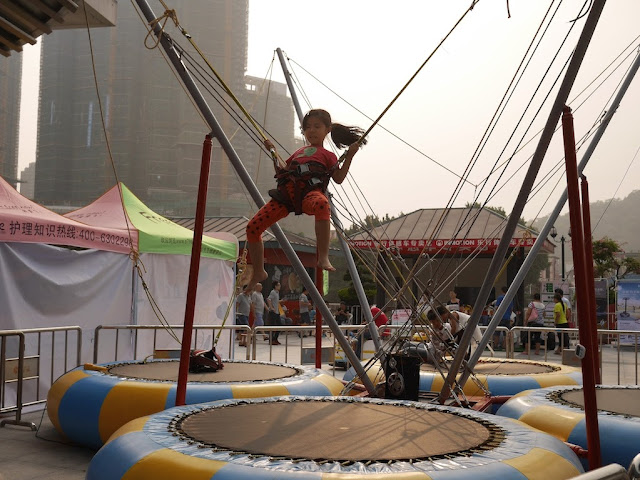 girl jumping on trampoline in Zhongshan, Guangdong