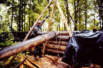 Photo: Hoisting a log up onto the wall. The hard way to do it!