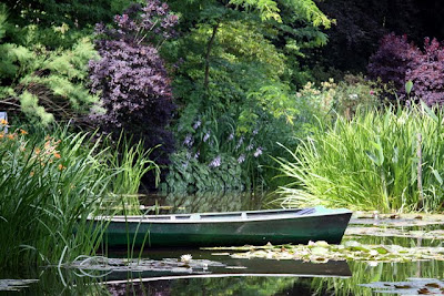 Boat in a pond in Monet's Gardens in Giverny France