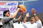 Bollywood super star Shahrukh Khan breaks Dahi Handi at Ghatkopar west in Mumbai on Thursday 29, 2013 for celebration for 'Janmashtami' organised by Ram Kadam to mark the birth of Hindu god Lord Krishna. Devotees take part in the dahi-handi celebrations during which people build a human pyramid until the pyramid is tall enough to enable the topmost person to reach an earthenware pot filled with milk, curds, butter, honey and fruits and which is suspended at a height of between 20 to 40 feet (about 6 to 12 meter). PIC/SHADB KHAN