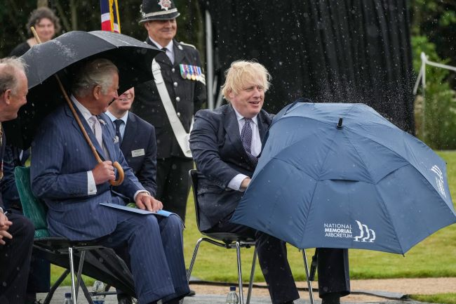 Prince Charles Keeps his Cool as Boris Johnson Struggles with Umbrella