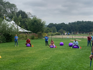 Corcoran Management Company employees competing in the bounce ball race in the relay event at Kimball Farm
