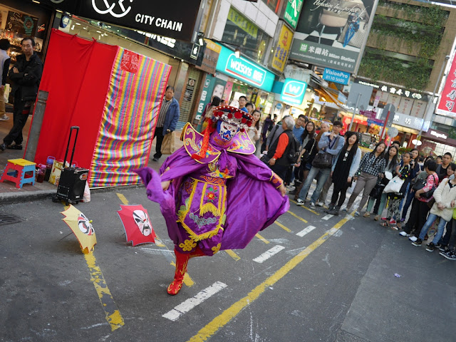 Sichuan style face changing performance at Sai Yeung Choi Street South