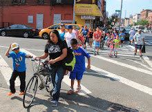 Sebastian, Perla and Jose help Cappy with his bike