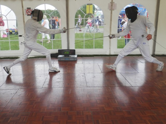 Dave Muir and Quentin Stokes in a modern epee duel, New Milton Pageant of Sport