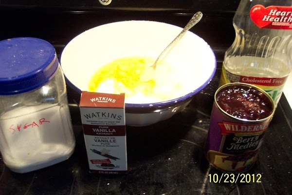 In another larger bowl... Mix together oil, sugar, vanilla and eggs.  ****Taste the canned fruit,...