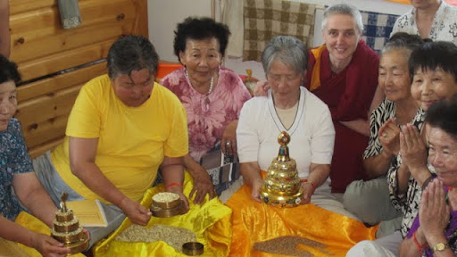 Ven. Sarah Thresher and women of Golden Light Sutra Center learning to make mandala offerings, Darkhan, Mongolia