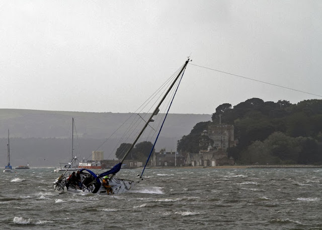The yacht's halyard is pulled over by the ILB whilst the ALB applies some pressure to the tow (out of shot) - 27 October 2013.  Photo credit: Mike Millard
