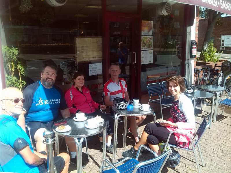 smiling cyclists at cafe