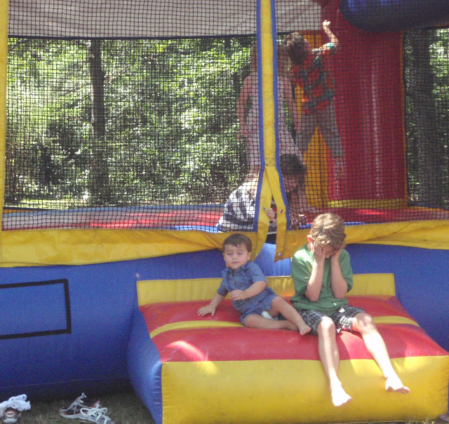 Children enjoy a 'bounce house'
