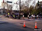 The half marathoners rounding the corner from Park to Monroe.