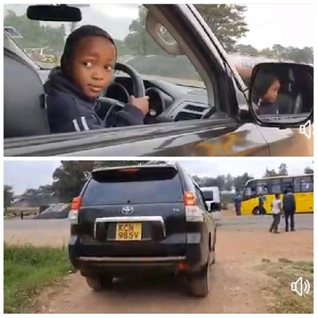 Small boy Ryan driving Prado TX