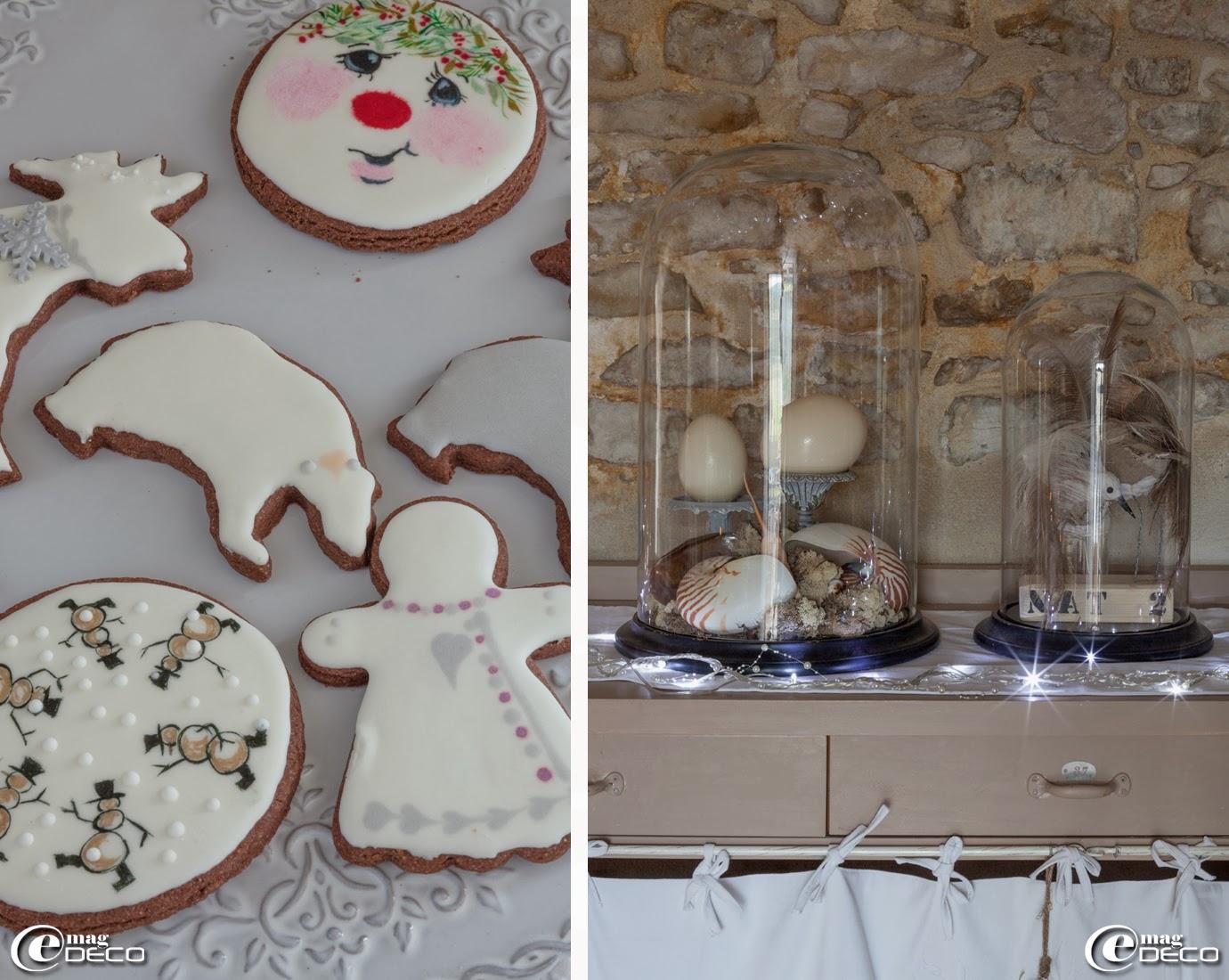 Petits biscuits de Noël décorés d'un glaçage royal préparés par Nina Couto de 'l'Atelier des Gourmandises', coquillages de l'île Maurice et œufs d'autruche présentés sous globes en verre