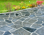 Random Black Flagstone Patio after a Rain