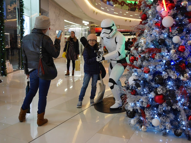 young woman posing with a Star Wars Stormtropper at the IAPM shopping center in Shanghai