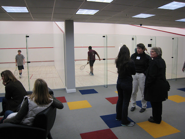 Onlookers in front of 2 of the 3 courts
