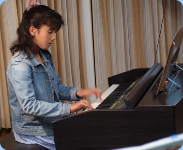 Hana Tani played the Yamaha Clavinova to start the evening off with pizzaz! Photo courtesy of Dennis Lyons.