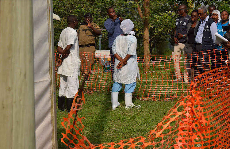 World Health Organization (WHO) officials talk to Ugandan medical staff as they inspect ebola preparedness facilities at the Bwera general hospital near the border with the Democratic Republic of Congo in Bwera, Uganda, June 12, 2019.