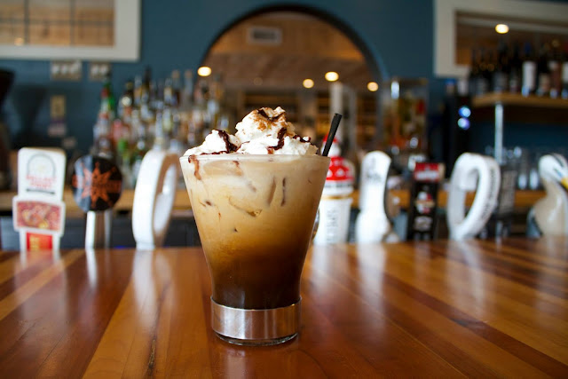 An Irishman in the Cold – Irishman Irish Cream and Whiskey, Honey, Valentine Espresso, Cinnamon, Milk, Whipped Cream cocktail.  Story Hill BKC. From Advice from a Local: 12 Best Places to Eat in Milwaukee