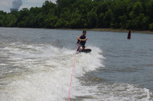 A photo Jessica, a fellow board member, knee boarding on the Ohio River on July 23, 2006. Photo by Nick Peyton.