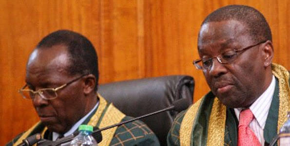 Justice Jackton Ojwang with former CJ Willy Mutunga. PHOTO | SG