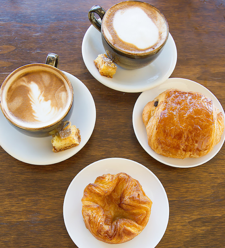 overhead photo of coffee drinks and pastries