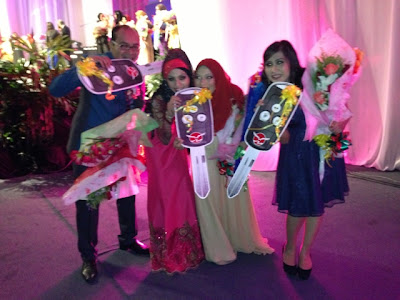 Car Fund achievers Hasbi, Norhafizah and Julianazriana at MIECC during Diamond Night Dinner