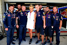 Pamela Anderson poses with members of the Infiniti Red Bull Racing team
