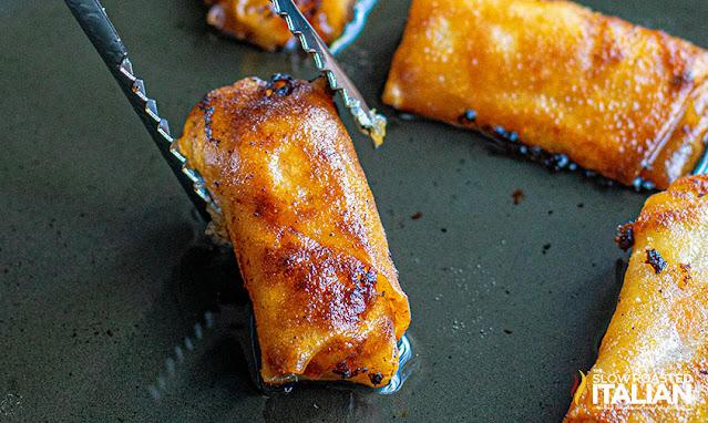 chicken spring rolls being fried