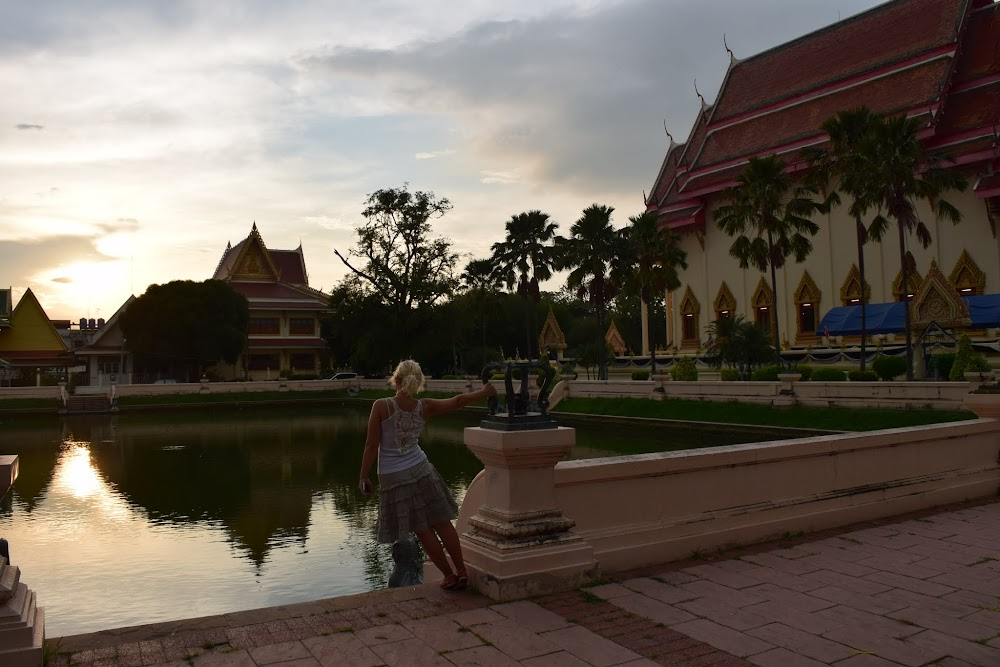 So... we head back into Buriram, again by hitch-hiking.  A woman on a motorbike stops for us and we both pile on.  She takes us right into the center of old town, which is also surrounded by a moat.  We then walk to this very impressive temple in time to witness the beginnings of an unbelievably beautiful sunset.