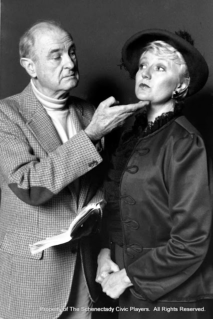 Peter Stewart and Pat Timm in a rehearsal photo for THE IMPORTANCE OF BEING EARNEST (R) - December 1989.  Property of The Schenectady Civic Players Theater Archive.