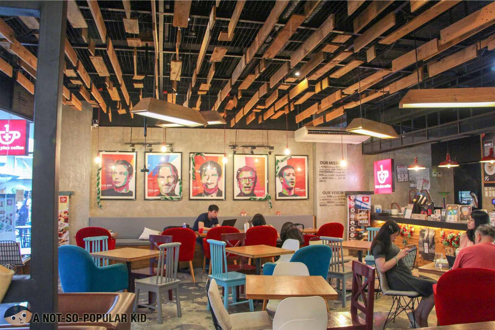 Modern yet comfy interior of One Plus Coffee in Circuit Mall