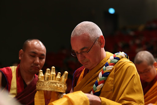Ven. Roger Kunsang offering mandala during long life puja Taiwan February, 2013.