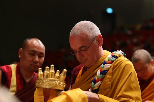 Ven. Roger Kunsang offering mandala during long life puja Taiwan February, 2013.