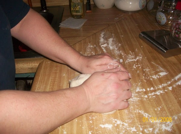Turn the dough out onto a lightly floured surface.  Knead until the dough...