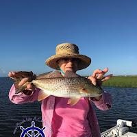 Juanita with a slot RedFish 08-04-2018