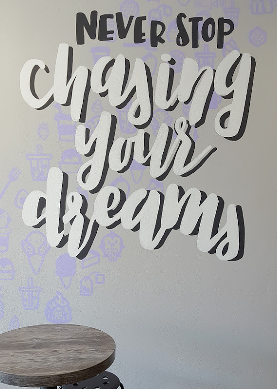 photo of a quote painted on a wall