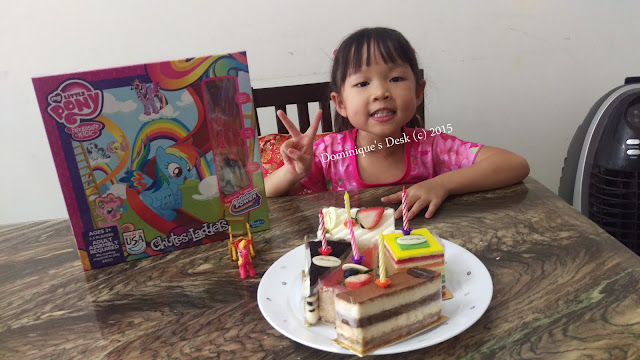 Tiger girl with her birthday cakes and present