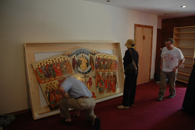 Faithful venerate the icon and inspects its beautiful artistry.