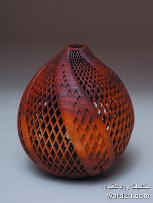 حفر على الخشب فازات ابداع الفنان J. Paul Fennell