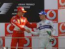 Michael Schumacher congratulates Robert Kubica's 1st podium