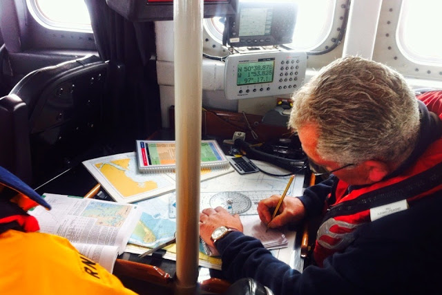 Volunteer crewman Wayne Belcher plots the wind and tide at the navigation table - 26 October 2014.  Photo credit: RNLI/Dave Riley