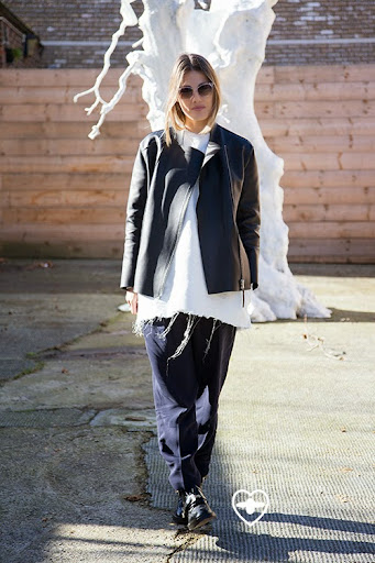 Natalie Hartley; fashion director Glamour; Leather jacket by All Saints; Trousers by Atea; Denim top by Marques Almeida; Boots Balenciaga; Sunglasses by Thierry Lasr;