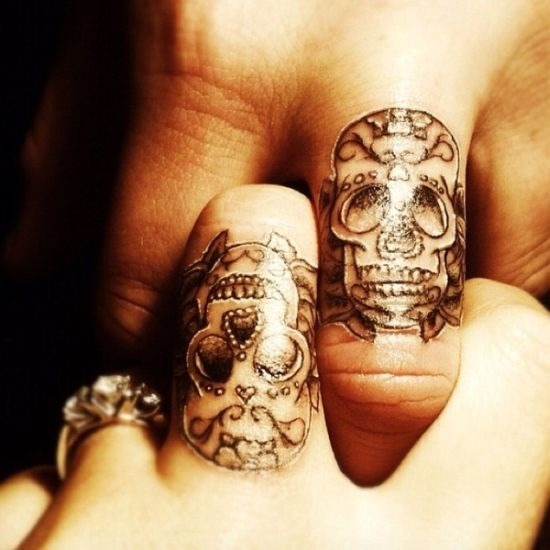Beautiful-sugar-skull-tattoos-on-fingers