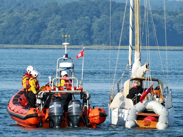 The ILB escorting the yacht within Poole Harbour - 08 August 2013.  Photo credit: Kevin Mitchell, Maritime Images